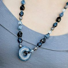 """Mommy Necklaces Dangling Donuts 28"""" Beaded Nursing Necklace with Dainty Baby Reusable Bag Bundle (Twilight) by Mommy Necklaces. $28.99. Mommy Necklaces 28"""" Dangling Donut design is the perfect nursing necklace and mommy jewelry. The moveable, dangling donut pendant is engaging and a unique design element. Whether it is a busy breastfed baby or a hair-pulling, hip-carried toddler, our classic Dangling Donut design has bead-dimension and major appeal. Mommy Necklaces ar..."""