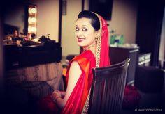 ....her face as perfect as a painting. ... #indianbride #indianwedding #candidweddingphotography #brideportraits #makeup #goldsmokeyeye #eyeliner #redlips #pinkblush #bindi #gajra #weddingsaree #duppata #simple #prettybride #anjumbhardwajmakeup #makeupartist #makeupartistcommunity #lovemyjob  #anjumbhardwajmakeup by anjumbhardwajmakeup