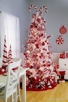 christmas tree red Craft your own Willy Wonka world with a Christmas candy cane tree. Decorate a faux white Christmas tree with red and white baubles and plenty of real candy canes for a sugary sweet theme Image: Hobby Lobby Pretty Christmas Trees, Candy Cane Christmas Tree, Christmas Tree Themes, Noel Christmas, Xmas Trees, White Christmas Tree With Red, Peppermint Christmas Decorations, Christmas Ideas, Whoville Christmas