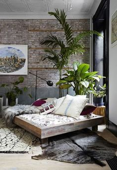 Industrial living room with unusual sofa and a little of boho feel