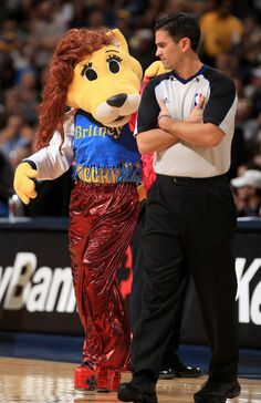 'Britney' the alter ego of Rocky the mascot of the Denver Nuggets flirts with referee Zach Zarba during a time out against the Oklahoma City Thunder at the Pepsi Center on January 20, 2013 in Denver, Colorado.