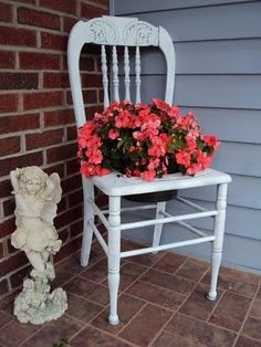 DIY- Cute repurpose for an old or broken chair. Cut a hole and sink a pot into it.