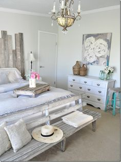 How gorgeous does this bench look? I absolutely adore the combo headboard and the bench. Again the bench probably won't fit BUT the headboard is a possibility! Idea via Becky's Farmhouse 18 Rustic Master Bedroom Decor Ideas | The Crafting Nook by Titicrafty