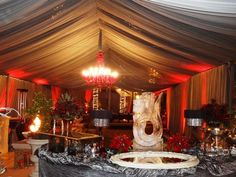 Christmas Party; Grey Chiffon Full Swagging with Red Chandelier and Red Uplighing