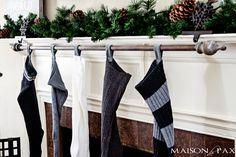 Classy (and cheap!) DIY stocking holder: use a curtain rod   via maisondepax.com #Christmas #diy #decor