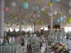 Add soft pastel colours to your wedding with robin egg, lime, white and pink paper lanterns