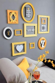 yellow frame collage love this would be easy and cheap to do around the two new big pictures on the wall behind the couch