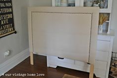 Upholstered headboard tutorial using painter's drop cloth and upholstery tacks…