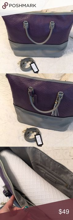 Purple and Gray Ostrich weekender bag Steve Madden HUGE weekender bag in great shape except for one little spot where the material is slightly rubbed off. (See pic #4) Purple is a faux ostrich texture and gray is a pebbled leather-like texture. Comes with tassel and ID tag. Brass accents. Shoulder strap included. Non smoking, cat-friendly home. That is a full-size pillow stuffed in to keep its shape for pics to give you an idea of size! Steve Madden Bags Travel Bags