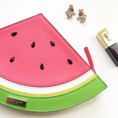 Kate Spade watermelon clutch Kate Spade watermelon clutch. Approximately 12 inches wide and 7.5 inches tall. Raised jewels for seeds on both sides. Brand new with tag. No trades. No PayPal. kate spade Bags Clutches & Wristlets