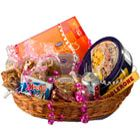Express your caring thoughts with this mouth-watering hamper of a) delicious butter cookies, b) assorted chocolates, c) pack of Toblerone chocolates d) biscuits and e) Dry Fruits.