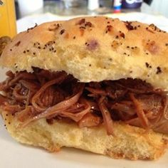 Beer BBQ pulled pork recipe (Add a rub from other pulled pork post).  Also added chicken stock, chopped onion & garlic.