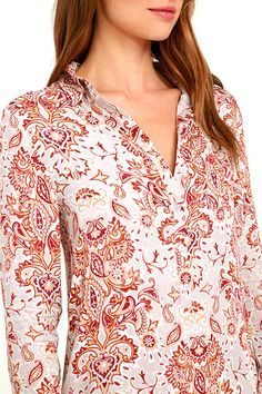 Set down a path of stylish possibilities with the White Crow Adrift Beige Print Shirt Dress! Lightweight woven rayon holds a dreamy beige, rust red, and tan print over a collared neckline, and long sleeves with button cuffs, (and button tabs). Partial button placket tops the sheath bodice with high-low hem.