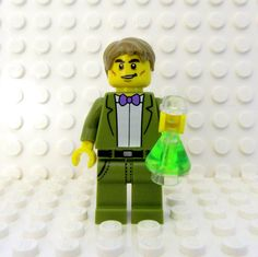 This listing is for one of my Bill Nye inspired keychains OR necklaces handcrafted from authorized LEGO® branded products that I custom assembled. In the drop-down list, you can choose to have Bill on a keychain, necklace or just the figure. For the keychain and necklace -- the figures parts are permanently and securely affixed -- his legs, arms and wrists still move. If you choose just the figure, Bill will arrive assembled (but NOT glued), and includes a small, black stand. That way you…