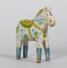 DALA HORSE, Swedish, folk art, early 20th century -- DALAHÄST, Olof Rytter Mattssons stil, 1900-talets början, höjd ca 20 cm