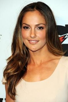 Minka Kelly....long, soft layers - subtle  well blended with plenty of texture. To add visual interest - cut cheekbone or chin grazing pieces of hair as this will give your face lift  shape, especially with your hair up. This cut works great with every face shape  normal to thick hair.`~I want her hair color!