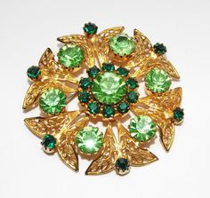 Vintage signed CELEBRITY NY green rhinestone filigree BROOCH Pin costume jewelry #CelebrityNewYork
