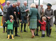 The prince, dressed in a traditional kilt and sporran, received a big hug from one of the twins, Gus, 5, which he fondly returned, a big smile across his face. Gus' twin, Louis, five, held on to her Grandmother's hand.