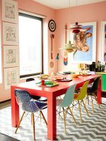 The Most Colorful Apartment We've EVER Seen #refinery29  http://www.refinery29.com/bradford-shellhammer-home-tour#slide-4  The bright sofas pop against the neutral Nanimarquina shag rug and grey wall. A Warhol hangs over the yellow couch. Also, why have one coffee table when you can have four? Shellhammer had these affordably custom-made.