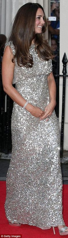 Duchess of Cambridge glitters in pale gold sequins as she attends first red carpet event since birth of Prince George