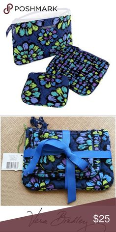 """NEW! VERA BRADLEY Medium Cosmetic Case -Indigo Pop NEW w/o tag - This is for the MEDIUM size cosmetic case/zip bag in the photo. Large and small are also available for purchase.  -Retired *beautiful Pattern- INDIGO POP  Measurements:  Medium: 7"""" X 5""""   Perfect for organizing things in your bag/ purse or items around the house. Case zips to keep everything inside and is machine washable.  PLEASE CHECK OUT ALL OF MY ITEMS!  (All of my items are from a Smoke Free, clean home) Thank you for…"""