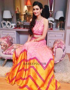Actress Diana penty in Priyal prakash lehenga. She looks gorgeous in ghagra choli and she was styled by Nidhi Jacob.