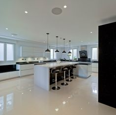 These ALNOSTAR high gloss white units were fitted in a client's kitchen in La Manga, Spain.