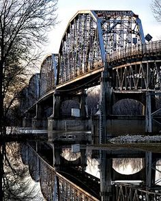 This is the bridge in New Harmony, IN. It links the small Indiana Communities to the small Illinois Communities. It is a four-span through truss toll bridge over the Wabash River and it was built in 1930.