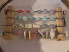 batch of bisque beads, coated with glaze and waiting to be fired in the kiln. #TheCreativeCottage