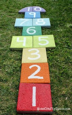 Super easy outdoor rainbow hopscotch - just use garden pavers and spray paint to add a fun splash of color to your yard! (Honest tip: use non-toxic, VOC free paint! But we have the hopscotch carpet still, remember? Backyard Playground, Backyard For Kids, Backyard Games, Playground Ideas, Lawn Games, Oasis Backyard, Preschool Playground, Kids Yard, Backyard Seating