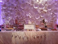 Sweet Love. Wedding desert table with Chanel inspired flower wall.