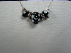 black and white polka dot lampwork beads -