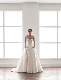 Karen Willis Holmes // Modern wedding dress in cream with a bustier and a full skirt