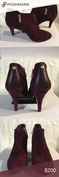 Vince Camuto Booties Absolutely gorgeous burgundy suede booties by VINCE CAMUTO. TRUE SUEDE. Lining: GENUINE LEATHER. Slim (4.5 inch) heels and a platform make these bootie both chic and comfortable. Golden zipper for better fit a expensive look.  ever been worn size 7 1/2 Vince Camuto Shoes Ankle Boots & Booties