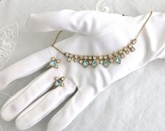Vintage rhinestone necklace and screw back earrings in gold metal, clear and pale blue rhinestones, circular and diamond shaped, mid… Rhinestone Necklace, Tassel Necklace, Thin Gold Chain, Screw Back Earrings, Vintage Jewellery, Vintage Rhinestone, Diamond Shapes, Earring Set, Rhinestones
