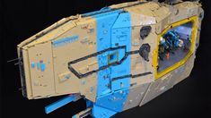 """The fantastic colors and the ship's name """"Anunnaki"""" are just one thing. The true awesomeness here is the huge hangar for LEGO mechs. This is a 30,000 piece monster, and it's big enough for three robots, all ready for their mission."""