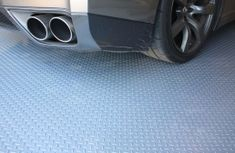 Diamond pattern nitro rolls offer the best value roll out vinyl garage floor covering on the market. Rolls can be used as a wall to wall garage flooring or as a mat or pad to cover one area of a garage. Similar to Coleman flooring. Vinyl Garage Flooring, Garage Flooring Options, Garage Floor Mats, Deck Flooring, Garage Floor Paint, Garage Walls, Car Floor Mats, Epoxy Garage Floor Coating, Garage Floor Coatings
