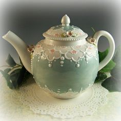 ♥♥♥ Spring Blossoms Teapoy ♥♥♥    Done in a wonderful shade of dusty teal, this teapot has a delightfully oriental flavor. Bands of fresh