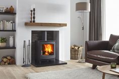 The Jens Keld 5 wood burning stove by Dik Geurts comes in two sizes; High and Low. The Keld Low is a great addition to an existing fireplace chamber due to it's 'snug' structure and shallow depth. The Keld High raises the stove up by which allows Log Burner Living Room, Home Living Room, Wood Burner Fireplace, Wood Stove Decor, Wood Burner Stove, Gas Stove, Inset Stoves, Wood Pellet Stoves, Ovens