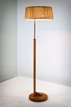 Aino Aalto, 1930's. Manufactured by Taito Oy, Helsinki. Birch, brass, and wicker.