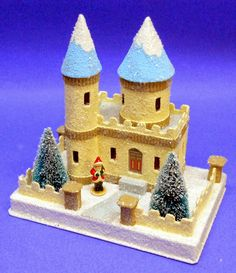 "Photo: castle house...5"" x 7 1/2"" x 3/4"" thick base...total height including base is about 8""...craft sand and bird cage gravel textured finish with glitter and mica highlights..."