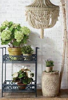 Classic styling and a graphic X and O pattern make up this timeless collection of planters and planter accessories. Designed to hold bright blooms and lush foliage indoors or out.