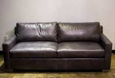 Gray Leather Hollywood Sofa available for rent from Holliday Flowers & Events Center! 901.729.2771