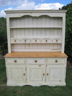 Another one with lots of little drawers. I would change the knobs for mix & match ceramic ones!