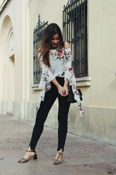#Spring outfit wearing off the shoulder floral blouse with ruffles, black jeans and strap sandals. #fashion #look #outfit
