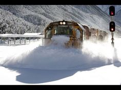 Spectacular footage Train plowing through deep snow  Arthurs Pass. Dont see this kind of snow very often!