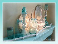 Aqua Ball Glass Jars. Insulators. Wire Basket. White Lights. Silver Trays.