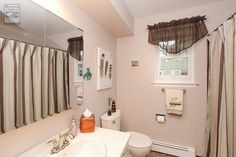 Charming bathroom in Nassau County, with newly installed double hung window... Home Remodeling / Home Improvement / Renovation / Replacement Window from Renewal by Andersen Long Island