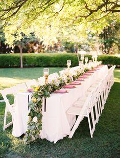 long garden reception table - photo by Ben Q Photography http://ruffledblog.com/whimsical-garden-wedding-in-dallas
