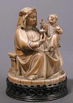 A German ivory figure of the Virgin and Child with an apple and a rose, c.1350-75. The rose symbolises Mary's birth 'as that of the purest flower among the thorns of sin sown by Eve. The apple held by the blessing infant Jesus signifies his identity as the new Adam.' MMA.